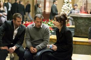From left to right: Bradley Cooper, Director David O. Russell, Jennifer Lawrence.
